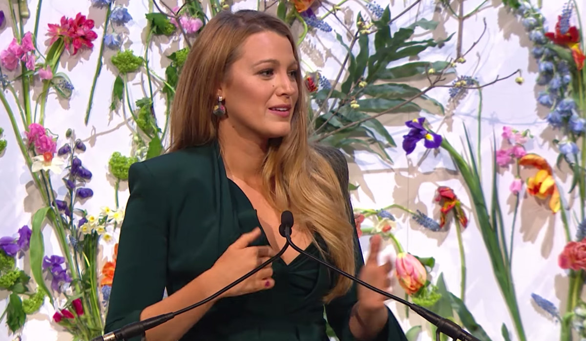 Actor Blake Lively at a microphone